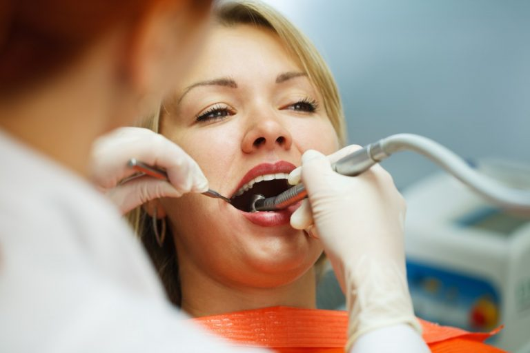 woman preparing for a dental surgery