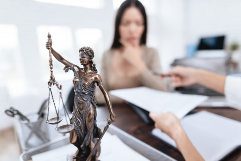 justice figurine in a law office