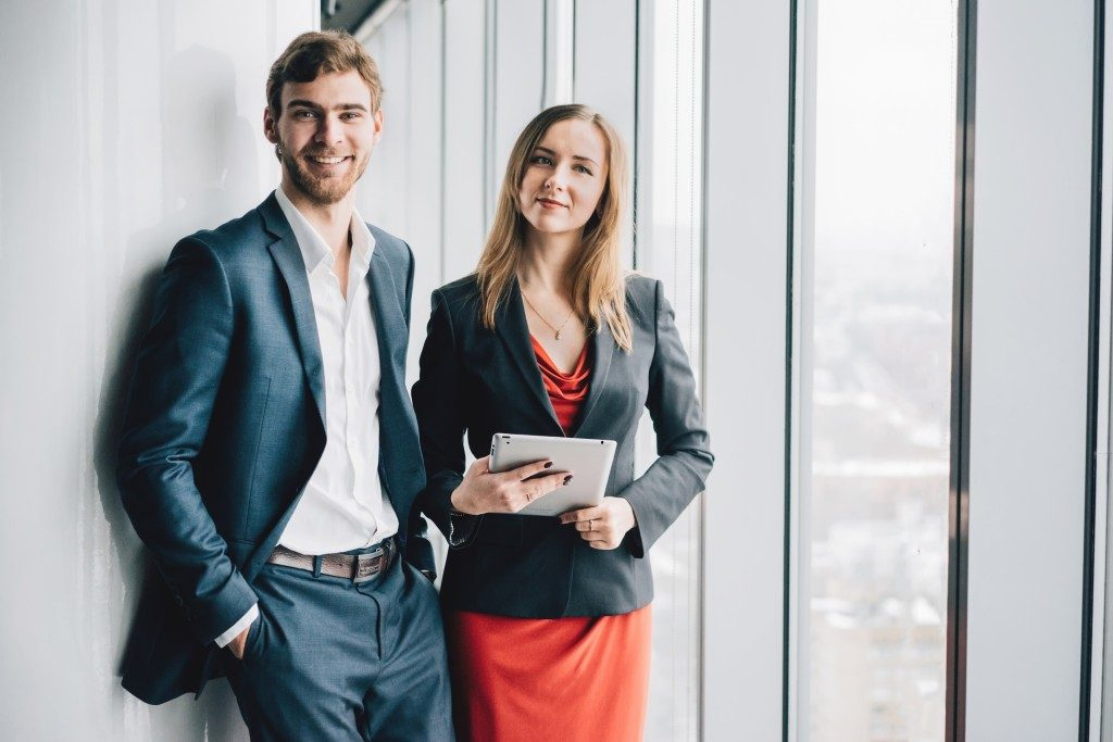 Man and woman wearing office attire