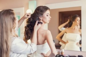 Bride having her hair fixed