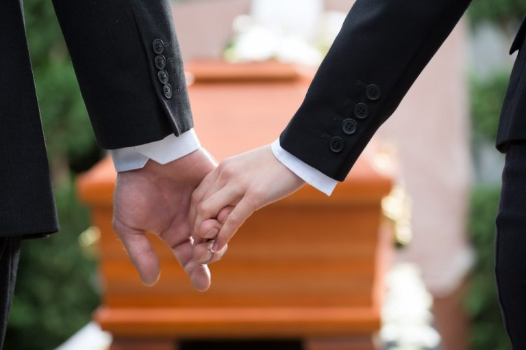 Holding hands during funeral