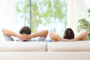 couple relaxing on the sofa