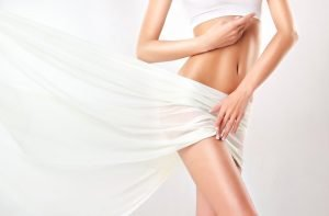 woman wearing white and wrapped in white sheet