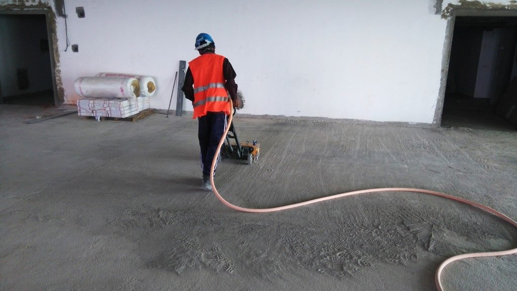 man cleaning the concrete floor