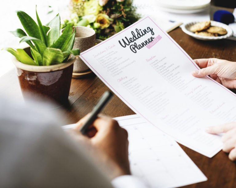 wedding planner holding a paper