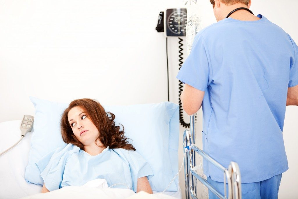 woman on the hospital bed
