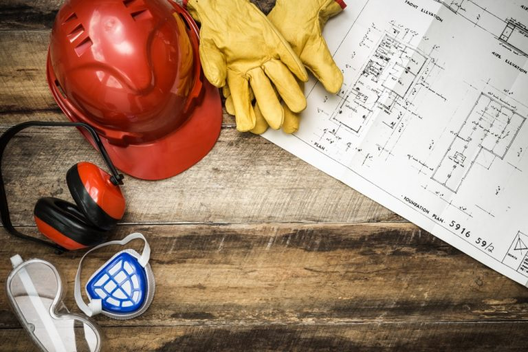 safety gear and blueprint of building
