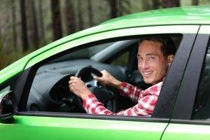 Man driving a bright green car