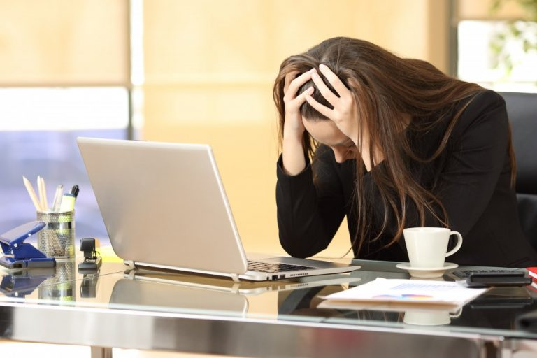 woman feeling stressed at work