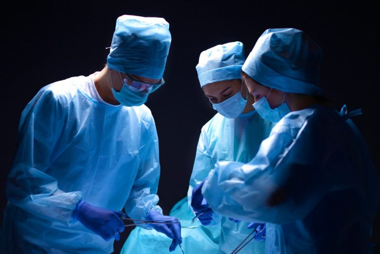 surgeons operating on a person