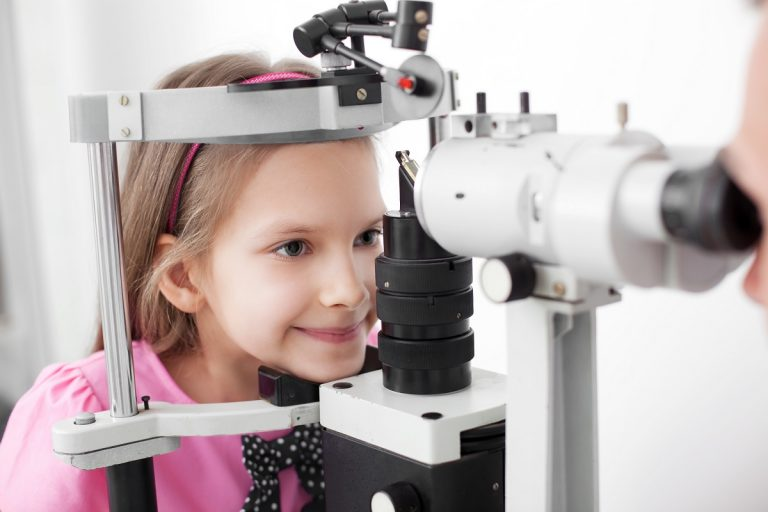 young girl having her eye checked