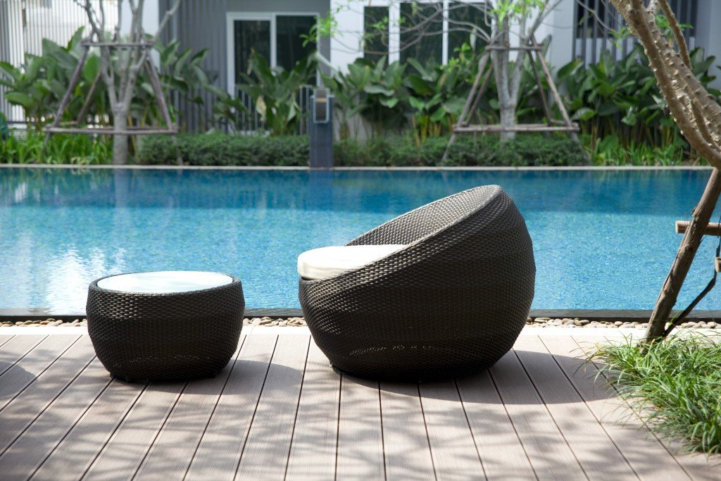rattan chairs and table on terrace