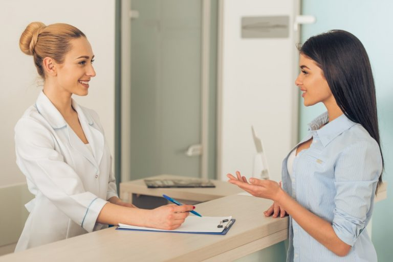 hospital receptionist with patient