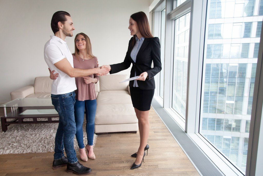 Couple talking to a real estate agent