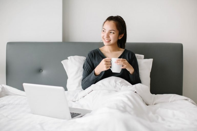 woman with a cup in bed