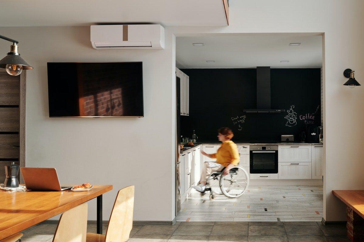 woman in wheelchair in the kitchen