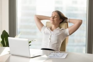 woman relaxing on her desk