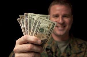 man holding cash