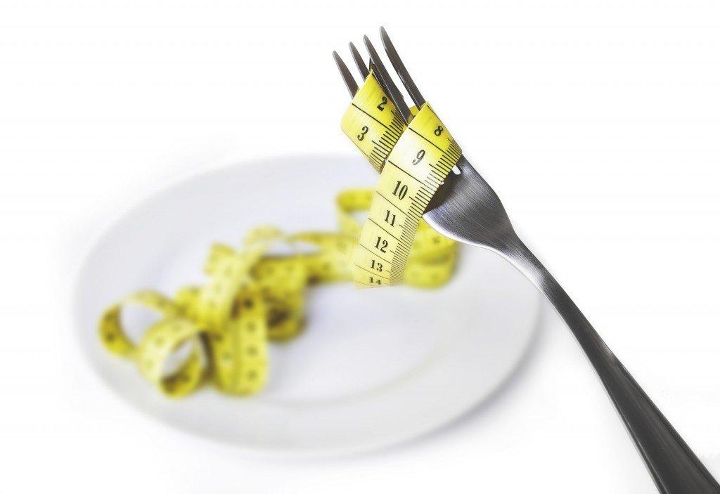 eating disorder concept using fork