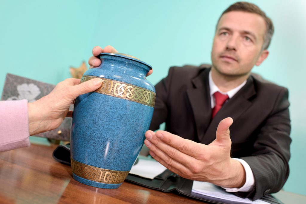 Lawyer with an urn
