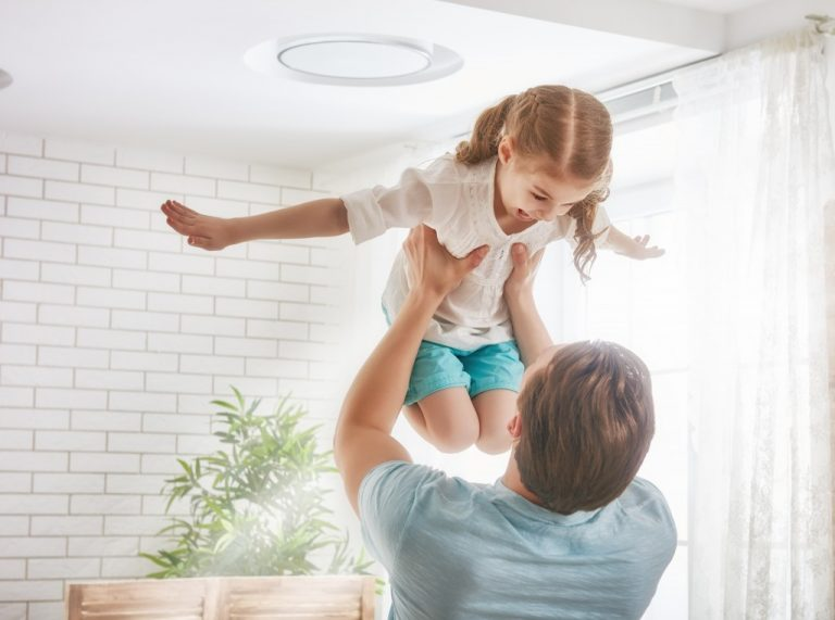 father lifting his daughter up