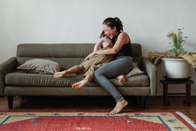 mother hugging child on sofa