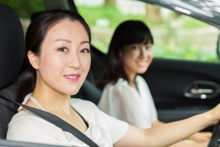 mother driving with daughter