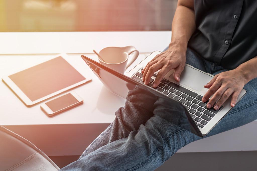 man writing a blog