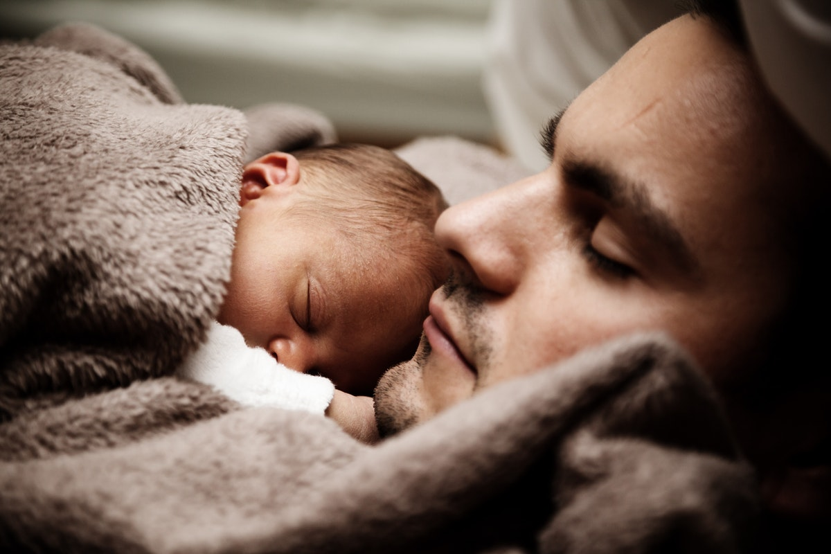 sleeping father and child